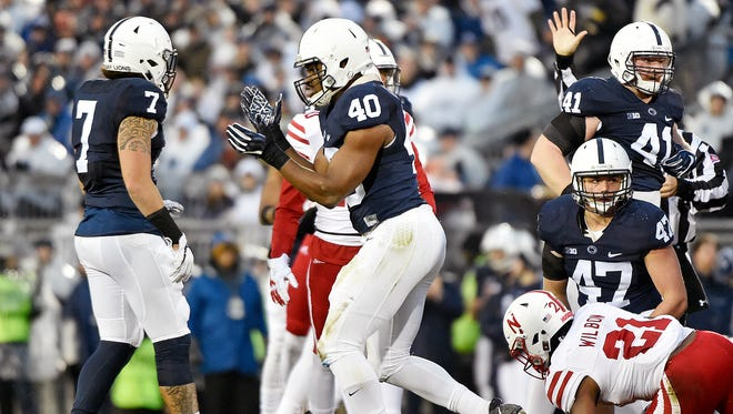 Penn State's Jason Cabinda (40) celebrates after making a tackle in the first half of an NCAA Division I football game Saturday, Nov. 18, 2017, at Beaver Stadium. Penn State defeated Nebraska 56-44 in its final home game of the 2017 season.