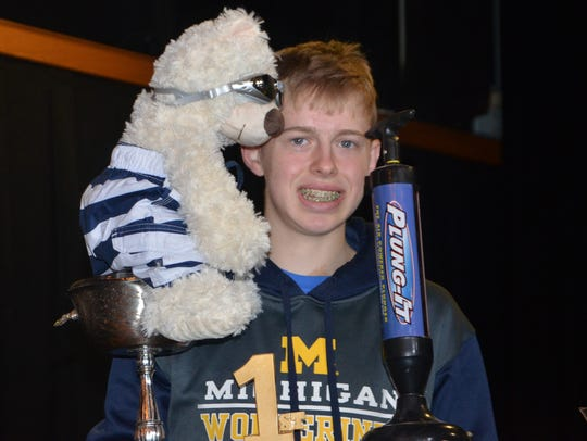 Max Zigterman,15, holds his trophy after being the