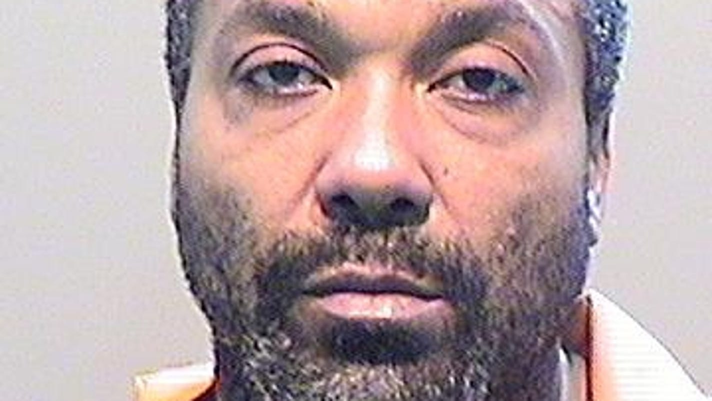 Man charged in officer's slaying to undergo competency exam