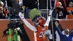 Cincinnati free safety Taylor Mays celebrates a safety after he blocked a punt during a game against the Jacksonville Jaguars on Nov. 2, 2014. ESPN is reporting that Mays has signed with the Detroit Lions.