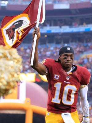 Washington Redskins quarterback Robert Griffin III (10) runs on the field prior to the Redskins game against the Philadelphia Eagles.