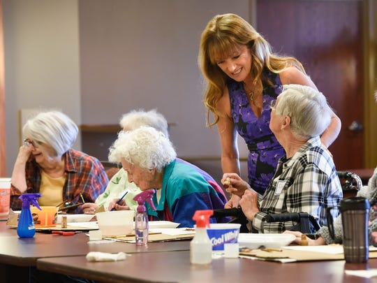 Actor Jane Seymour smiles while talking with seniors during an art class at St. Benedict's Senior Community Friday, May 5, in St. Cloud.