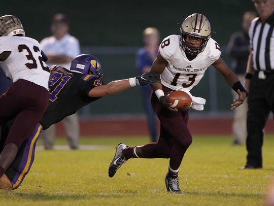 Brebeuf Jesuit quarterback Derrick Ozobu (13) has the