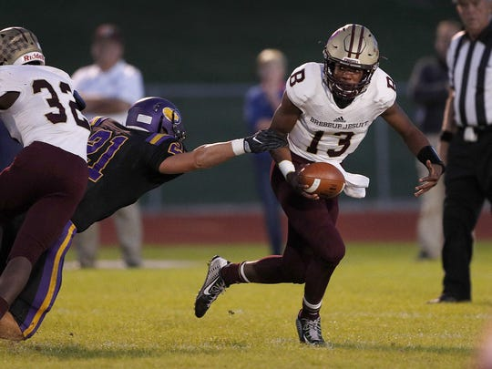 Brebeuf Jesuit quarterback Derrick Ozobu (13) has the Braves a win away from a state title.