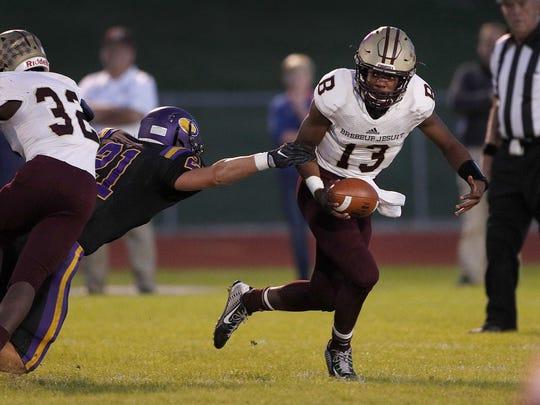 Brebeuf Jesuit quarterback Derrick Ozobu (13) has the
