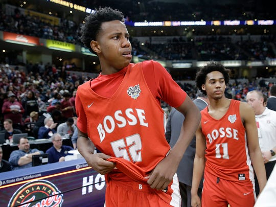 A dejected Evansville Bosse Bulldogs Kiyron Powell (52) following their IHSAA 3A boys basketball state finals game at Bankers Life Fieldhouse on Saturday, March 24, 2018. TheCulver Academies Eagles defeated the Evansville Bosse Bulldogs 64-49.
