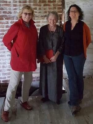 Nancy Theiss, left, Taylor descendant Robin Loucks and Arkansas archaeologist Jodi Barnes posed inside the Hollywood dogtrot home of  John Martin and Mary Elizabeth Taylor.
