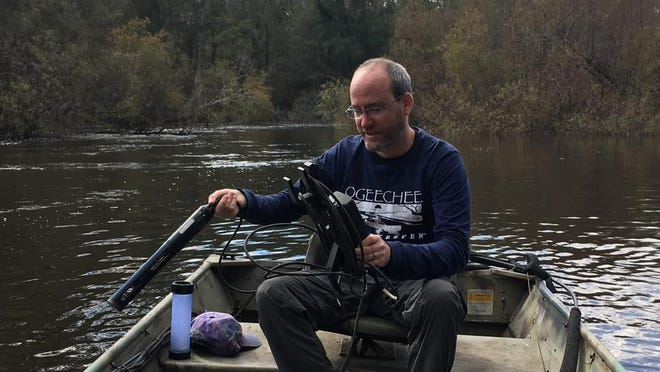 Ogeechee Riverkeeper and Executive Director Damon Mullis at work on the river.