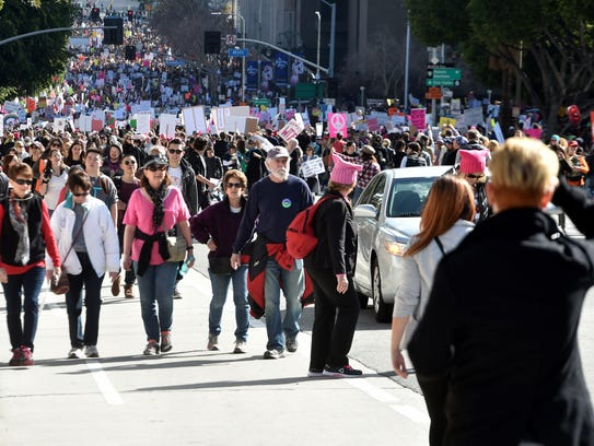 Thousands of people march in the streets of downtown