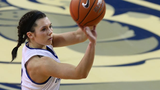 Drake's Kyndal Clark makes a first-half 3-pointer against Bradley in their game Sunday, January 26, 2014 at Knapp Center.