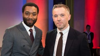British actor, Chiwetel Ejiofor, left, with the Irish-born artist Duncan Campbell who has won this year's Turner Prize for his series of films called It for Others at Tate Britain in central London Dec. 1.