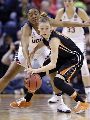 Connecticut Huskies forward Morgan Tuck (3) knocks the ball away from Oregon State Beavers guard Jamie Weisner (15) in the first half of their NCAA Women's Basketball National Semifinal game Sunday, Apr 3, 2016, evening at Bankers Life Fieldhouse.