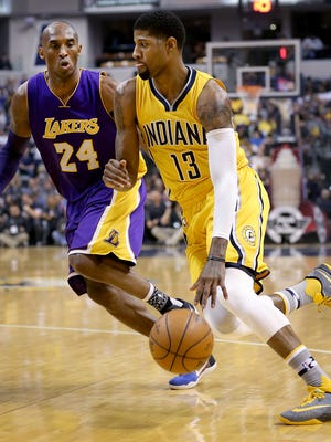 Indiana Pacers forward Paul George (13) drives on Los Angeles Lakers forward Kobe Bryant (24) in the first half of their game. The Indiana Pacers host the Los Angeles Lakers Monday, Feb8, 2016, evening at Bankers Life Fieldhouse.