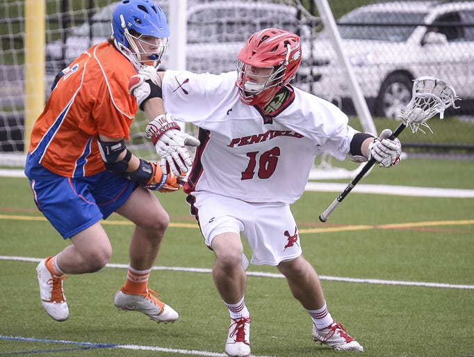 Penfield's John Condon, right, fights off Penn Yan's Casey Marsh, left, during the Patriots' 16-5 win Saturday.