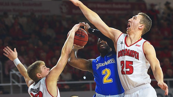 SDSU's Tevin King attempts to score past USD's Tyler