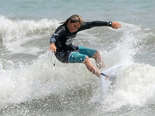 William Hededston cuts back on a wave during the Easter Surfing Festival at Lori Wilson Park.
