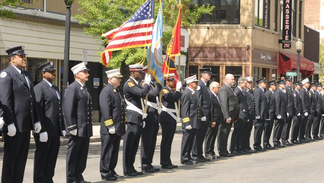 Firefighters from various departments line Main Street in the City of Poughkeepsie while awaiting the funeral procession for fallen firefighter Timothy Gunther.