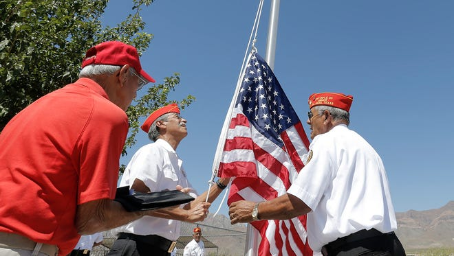 Marine veterans with the 19th Rifle Company hold a ceremonial flag raising in front of the new El Paso Veterans One Stop Center at 9565 Diana Drive in Northeast El Paso.