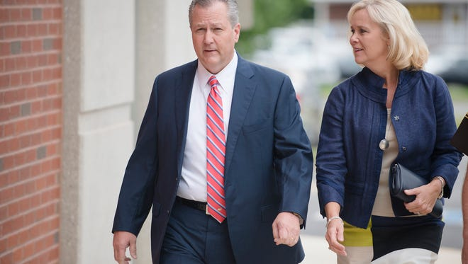 Mike Hubbard, former Alabama Speaker of the House, and his wife, Susan, walk together for a post trial hearing at the Lee County Justice Center in Opelika, Ala., on Friday, Sept. 2, 2016.