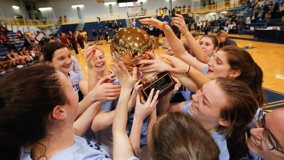 Rye players hoist the gold ball after defeating Harrison,