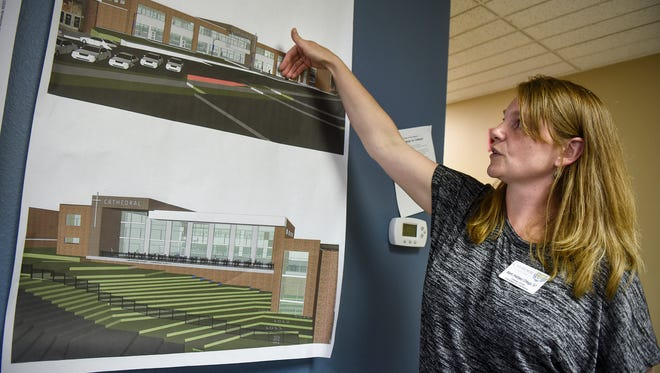 Campaign for Cathedral Director Marit Ortega points out features of the new Cathedral High School building Monday, July 9, in St. Cloud.