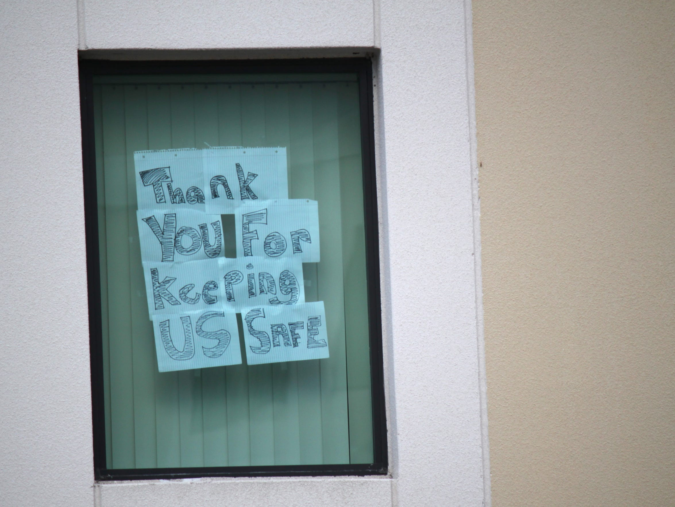 A sign posted in a Tower 1 window after the near tragedy.