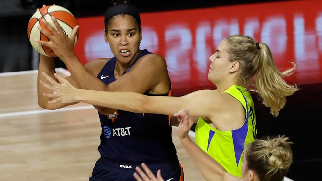 Connecticut Sun center Brionna Jones (42) passes in front of Dallas Wings forward Bella Alarie (32) during the Sun's victory Wednesday in Bradenton, Fla.