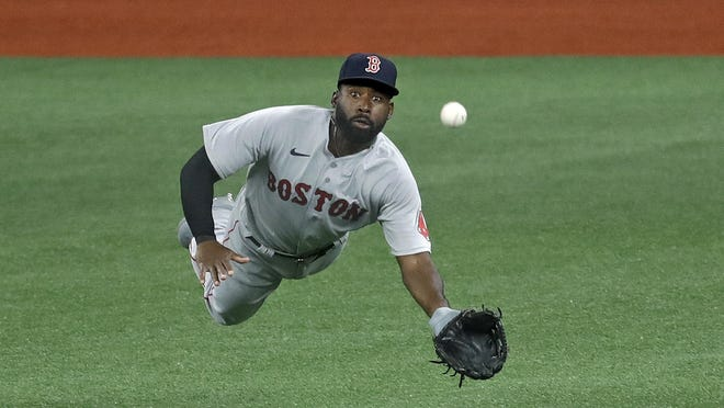 Jackie Bradley Jr. hurt his left wrist making a diving catch like this one in Tampa Bay.