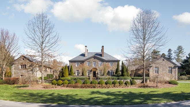 An estate designed for the late former president of Coca-Cola Bottling Company of Asheville sold for $7.7 million, becoming the most expensive home sale in the city.