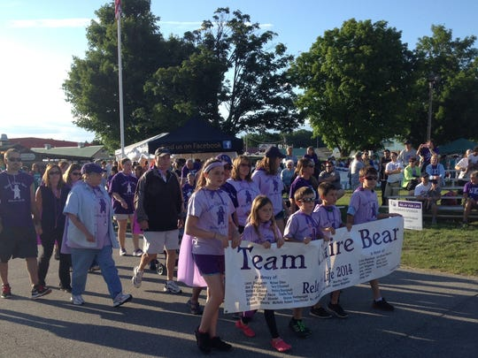 Members of Team Claire Bear march in the Relay For Life on Friday night.