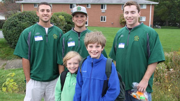 My boys with members of the College at Brockport's baseball team they met along the walk.