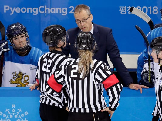 head coach Pasi Mustonen argues with referees during the first period of the semifinal round of the women's hockey game against the United States at the 2018 Winter Olympics in Gangneung, South Korea, Monday, Feb. 19, 2018. (AP Photo/Julio Cortez)
