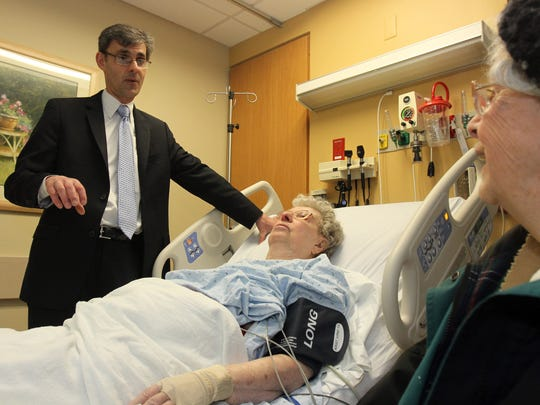 Dr. Victor Almeida speaks to patient Veronica Malone of Jackson and her neighbor Mary Harley of Jackson in the geriatric emergency department at Monmouth Medical Southern Campus in Lakewood in this 2014 file photo.