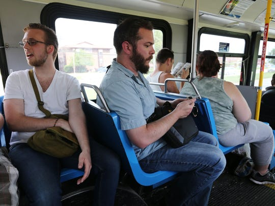 A smartphone is a handy tool for checking routes and bus schedules.