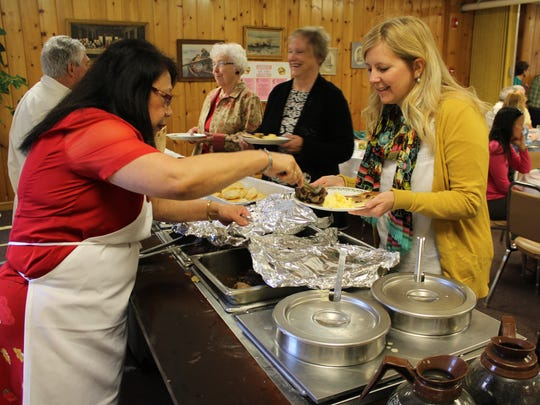 Volunteers at the Ursuline Center in Great Falls serve Mother's Day Brunch to guests at the 103-year-old facility on Sunday