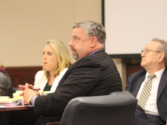 Attorneys Carrie Gasaway, left, and Fletcher Long, center, faced charges of extortion.