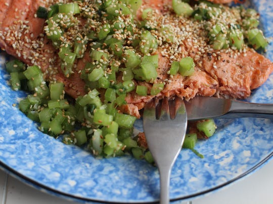 Grilled coho salmon is served with sesame celery relish.