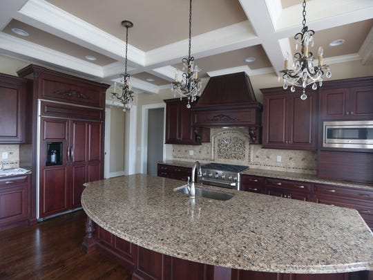 The kitchen in a finished custom estate home in the Waterford neighborhood at The Reserve.
