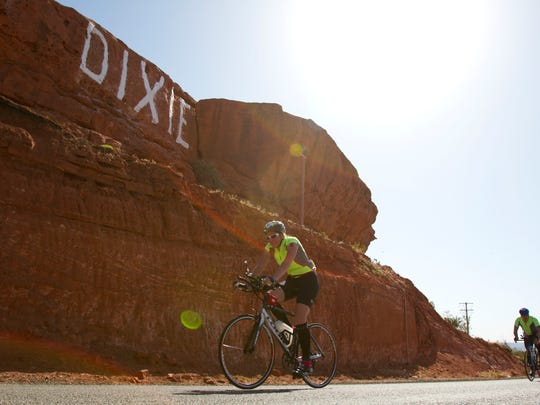 """Athletes compete during the cycling portion of the St. George Ironman 70.3, passing along Snow Canyon Parkway above the central part of St. George. State officials are celebrating Bike Month this May, with three Washington County cities being named as """"Road Respect"""" communities for their efforts to be more bike-friendly."""