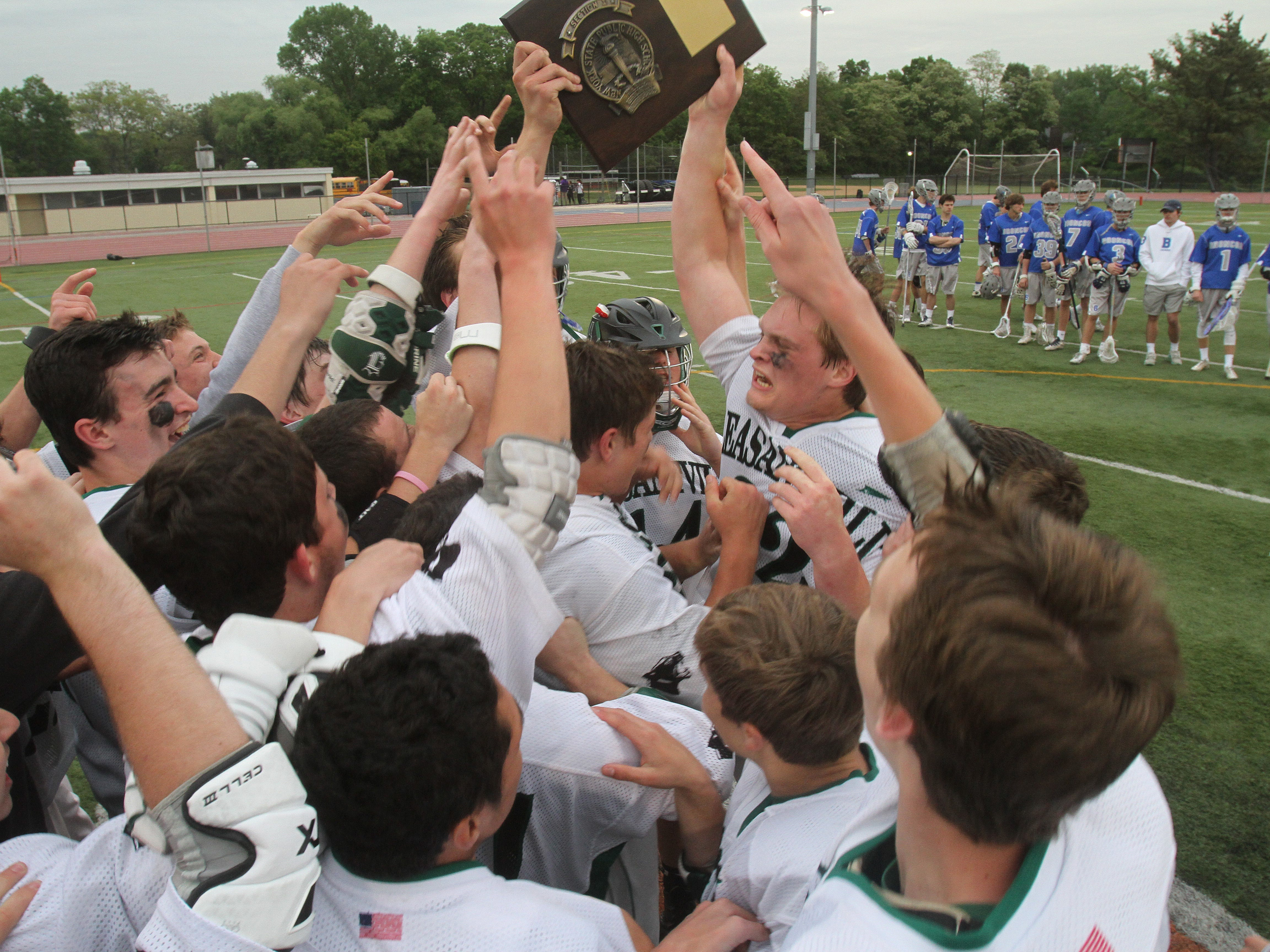 Pleasantville players celebrate their 9-7 victory over defending state champs Bronxville in Section 1 boys lacrosse championship game at White Plains High School May 21, 2015.