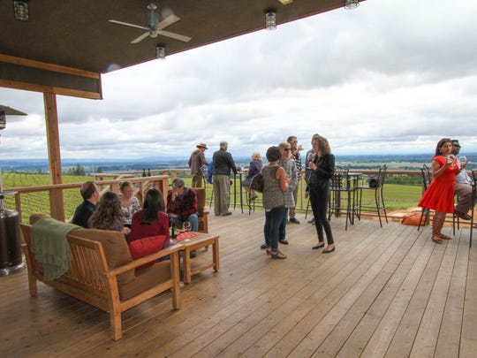 Visitors enjoy the deck at Brooks Winery on Saturday, May 23, 2015