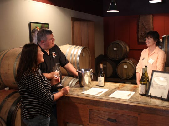 Lisa Becker (left) and John Boots taste wine at The Eyrie Vineyards in McMinnville on Saturday, May 23, 2015.