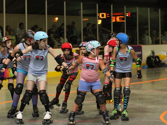 In roller derby, one skater on each team is called a jammer (identified by a star on the helmet) and the other four are called blockers. The blockers try to clear each other out, allowing the jammer to pass the other team's skaters and earn points.