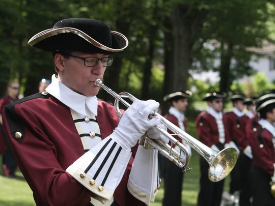 Daniel Ribaudo of Morristown High School performs taps during the Memorial Day ceremony in Morristown.