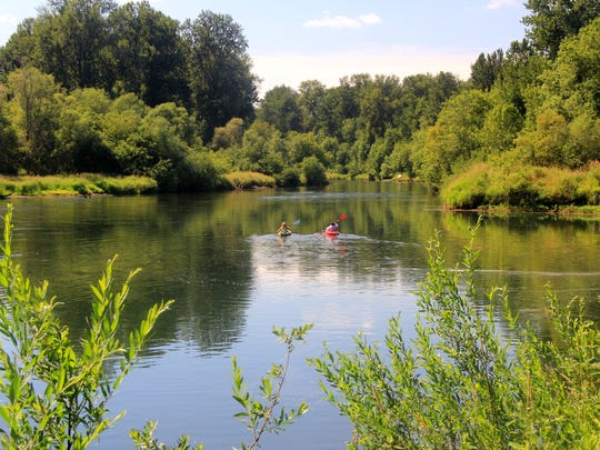 Kayakers explore the Willamette River near Grand Island.