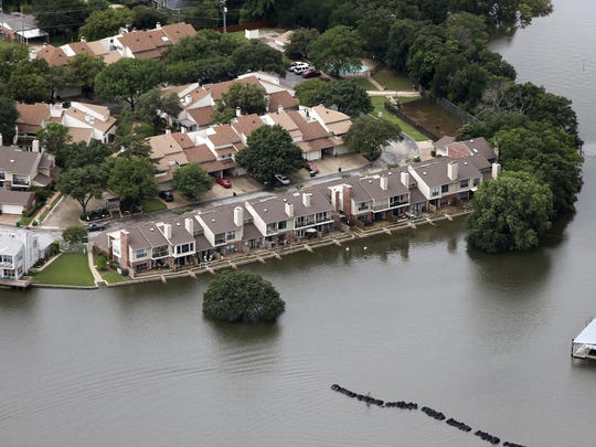 Lake Lewisville encroaches upon multi-family dwellings, Friday, May 29, 2015, in Lewisville, Texas. Floodwaters submerged Texas highways and threatened more homes Friday after another round of heavy rain added to the damage inflicted by storms.