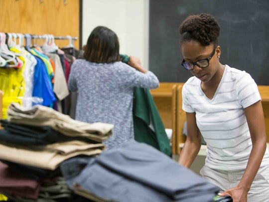 Tamika Lee, a site director with Community in Schools at AI duPont High School, helps kids get over out-of-school issues like friends who are killed, parents losing jobs, and pregnancies. She has a room full of donated clothes from school faculty and supplies that she gives out to students who can't meet dress code.