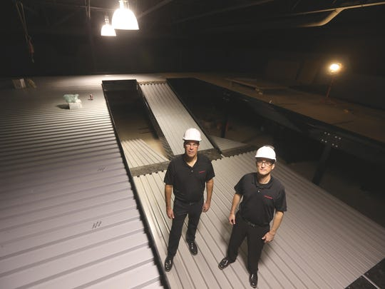 Jim Kessler, left, and brother Steve, stand in the Lasertron sports arena.