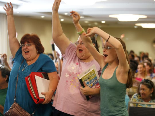 Terri Carlton, from left, Nancy Taylor and Mikayla Jones show their enthusiasm for savings during gift card giveaway at an Extreme Couponing workshop at the Four Points Hotel organized by the Tallahassee Democrat.
