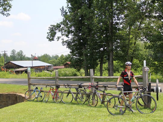 A Cycle to Farm rider takes a rest last year on the 62-mile tour to visit several Western North Carolina farms. The fourth annual Cycle to Farm is July 18.